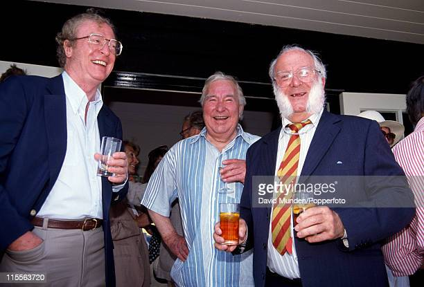 Former England cricketers Godfrey Evans and Denis Compton with Michael Caine attending a charity cricket match at Wormsley 24th May 1992