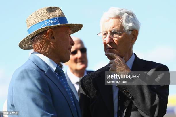 Former England cricketers Mike Brearley and Geoff Boycott chat during celebrations for the fiftieth Edgbaston Test Match during lunch on day one of...