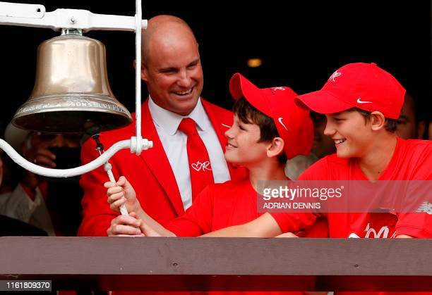 Former England crickter Andrew Strauss and his two sons Luca and Sam ring the five minute bell dressed in red to show support for The Ruth Strauss...