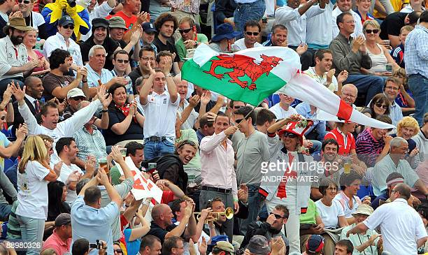 Former England fast bowler Simon Jones joins fans in the crowd during the fourth day of the first Ashes cricket Test match in Cardiff, in Wales, on...
