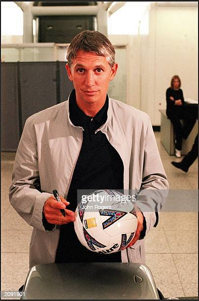 Former England footballer and current BBC Sports TV presenter Gary Lineker takes a break from filming at Stansted Airport England in June 2000 The...