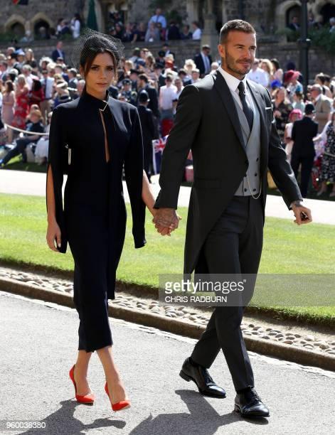 Former England footballer David Beckham and fashion designer Victoria Beckham arrive for the wedding ceremony of Britain's Prince Harry Duke of...