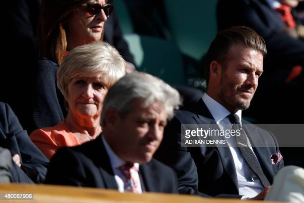 Former England footballer David Beckham and his mother Sandra sit on entre court watching the action on day ten of the 2015 Wimbledon Championships...