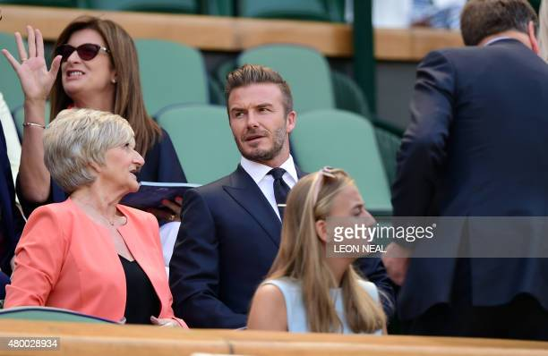 Former England footballer David Beckham sits in the royal box on centre court to watch the women's semifinal matches on day ten of the 2015 Wimbledon...