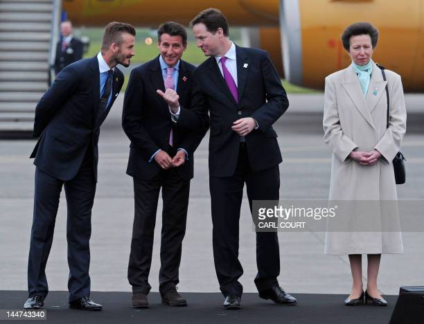 Former England footballer David Beckham speaks with 2012 Chairman Lord Sebastain Coe and Deputy Prime Minister Nick Clegg as Britain's Princess Anne...