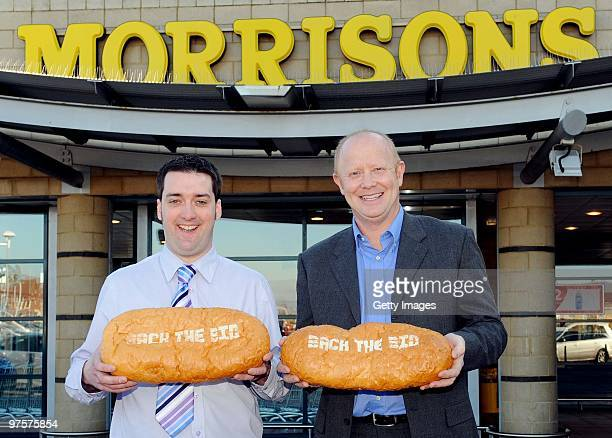 Former England footballer Mark Wright and Jason Nicholson deputy store manager pose during a photo call to promote Morrisons as a sponsor of the...