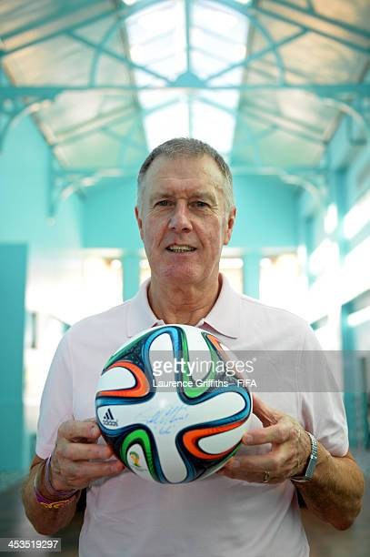 Former England footballer Sir Geoff Hurst poses with the adidas Brazuca official match ball for the 2014 FIFA World Cup Brazil during previews ahead...