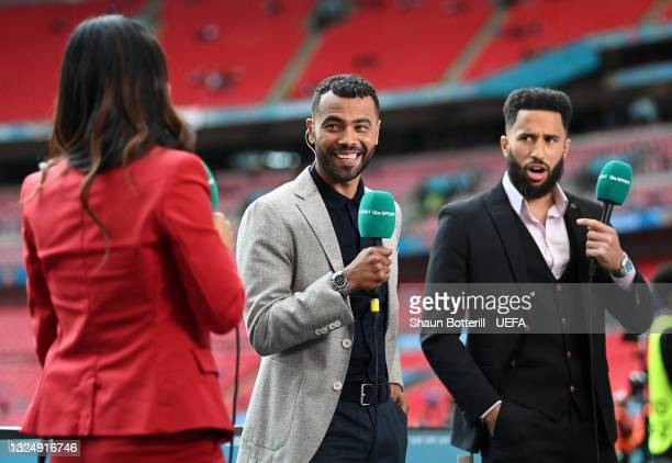 Former England International and TV Presenter, Ashley Cole and Crystal Palace footballer and TV Presenter, Andros Townsend look on prior to the UEFA...