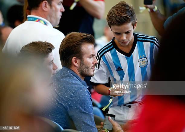 Former England international David Beckham and sons Brooklyn Beckham and Romeo Beckham prior to the 2014 FIFA World Cup Brazil Final match between...