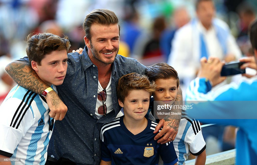 Former England international David Beckham and sons Brooklyn Beckham (L), Cruz Beckham (2nd R) and Romeo Beckham (R) prior to the 2014 FIFA World Cup Brazil Final match between Germany and Argentina at Maracana on July 13, 2014 in Rio de Janeiro, Brazil.