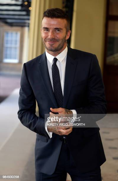Former England international David Beckham arrives to attend the Queen's Young Leaders Awards Ceremony on June 26, 2018 at Buckingham Palace in...