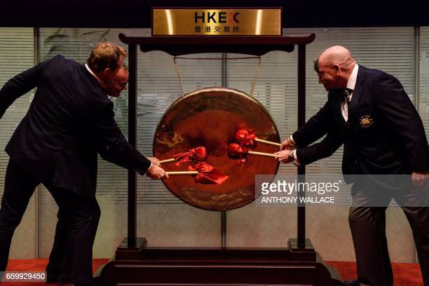 TOPSHOT Former England international rugby player Josh Lewsey bangs a gong at the official launch of the GFI Hong Kong Football Club 10s ceremony in...