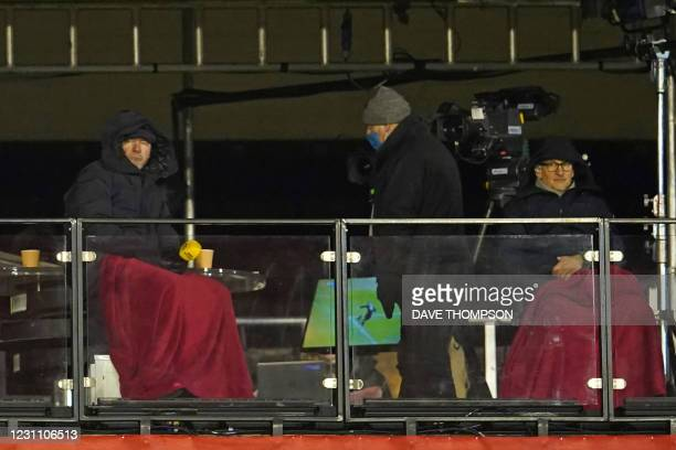 Former England internationals Alan Shearer and Gary Lineker wrapped up against the cold, watch from their makeshift TV studio during the English FA...