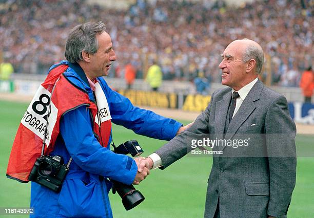 Former England manager Sir Alf Ramsey is greeted by veteran sports photographer Monte Fresco prior to the FA Cup Final between Nottingham Forest and...
