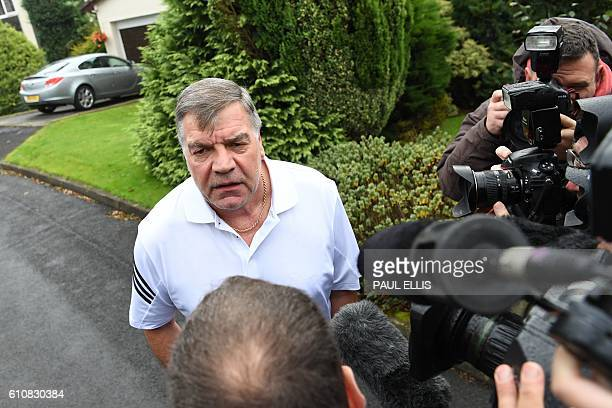 TOPSHOT Former England national football team manager Sam Allardyce speaks to the press outside his home in Bolton on September 28 2016 Sam...