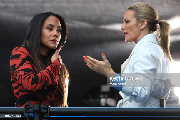 Former England player Alex Scott speaks with presenter Gabby Logan prior to the 2019 FIFA Women's World Cup France group D match between England and...