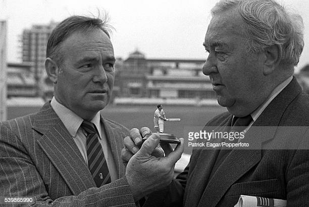 Former England player Denis Compton is presented with a figurine of himself by Wisden Cricket Monthly editor David Frith at Lord's Cricket Ground in...