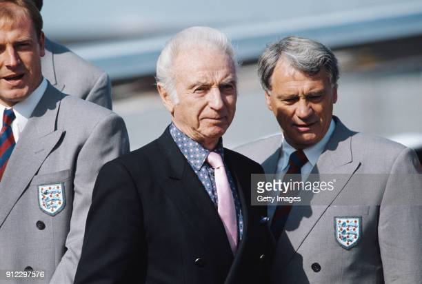 Former England player Stanley Matthews chats with manager Bobby Robson as player Steve McMahon looks on as England prepare to leave for the 1990 FIFA...