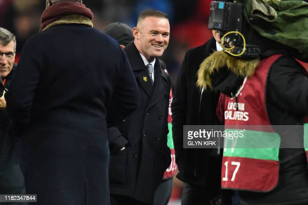Former England player Wayne Rooney parade on the pitch at half time as England celebrate playing their 1000th International match during the UEFA...