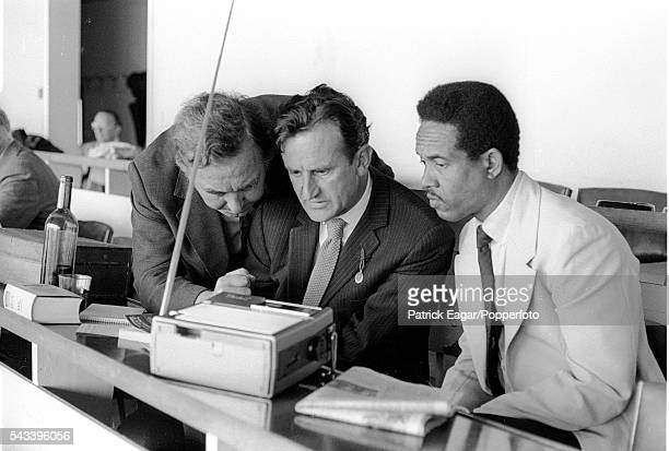 Former England players Denis Compton and Ted Dexter watching a horse race with former West indies player Garry Sobers on a portable television in the...