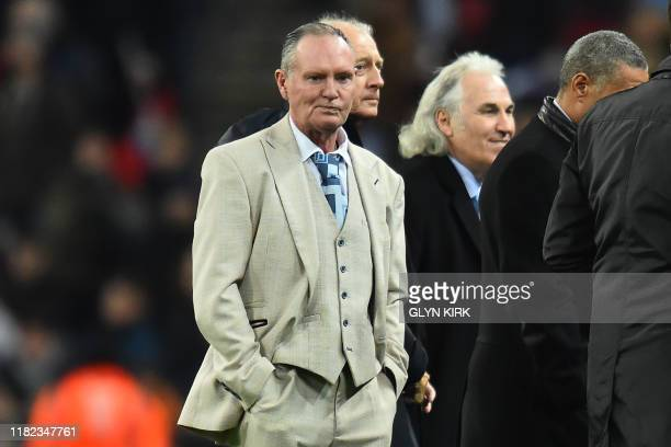 Former England players including Paul Gascoigne parade on the pitch at half time as England celebrate playing their 1000th International match during...