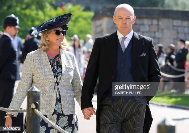 Former England rubby coach Clive Woodward and Jayne Williams arrive for the wedding ceremony of Britain's Prince Harry Duke of Sussex and US actress...