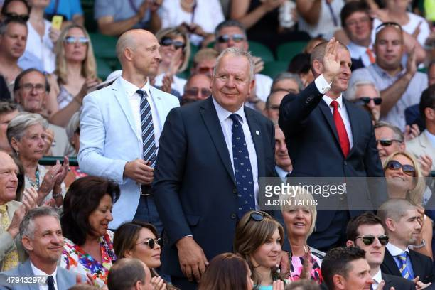 Former England rugby captain Bill Beaumont and England national rugby union head coach Stuart Lancaster stand and wave in the royal box on centre...