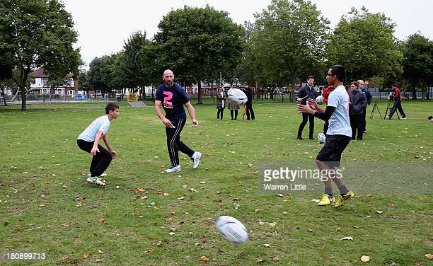 Former England rugby international Lawrence Dallaglio coaches local children who will have first access to the newly installed posts at Inwood Park...