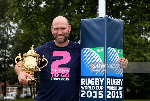 Former England rugby international Lawrence Dallaglio poses with the Webb Ellis Cup after coaching local children who had their first access to the...