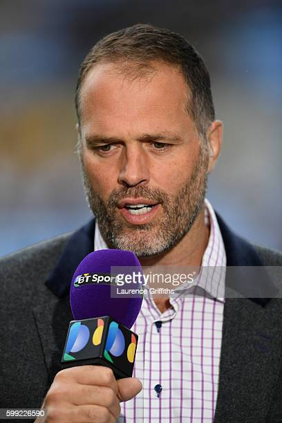 Former England Rugby player and BT Sport presenter Martin Bayfield looks on during the Aviva Premiership match between Wasps and Exeter Chiefs at...
