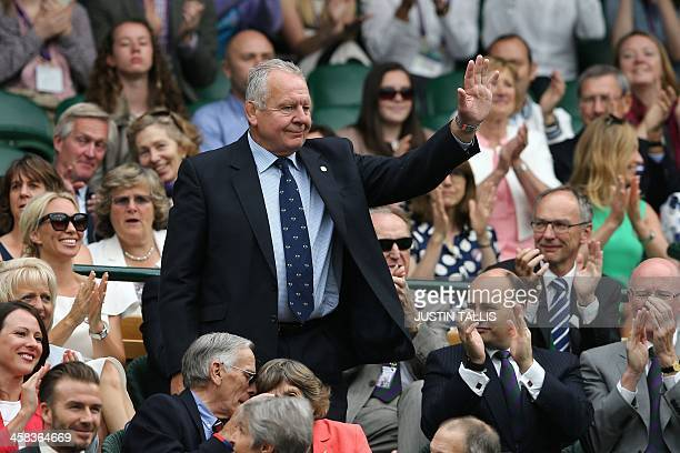 Former England rugby player Bill Beaumont stands in the royal box on centre court as he is introduced on the sixth day of the 2016 Wimbledon...