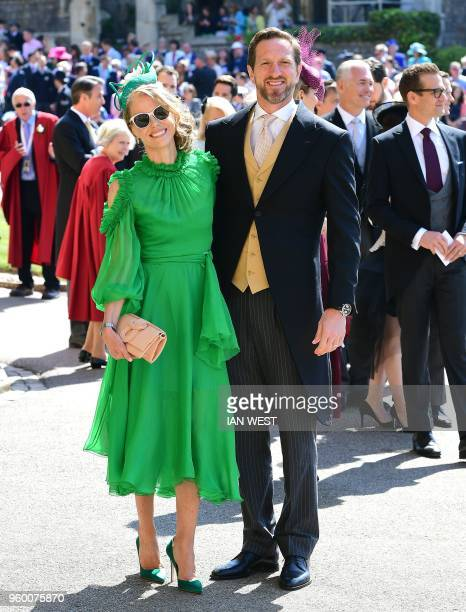 Former England rugby union player Will Greenwood and his wife Caroline pose for a photograph as they arrive for the wedding ceremony of Britain's...