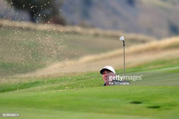Former English cricketer Sir Ian Botham plays a bunker shot during day one of the ISPS Handa New Zealand Golf Open at The Hills Golf Club on March 1...
