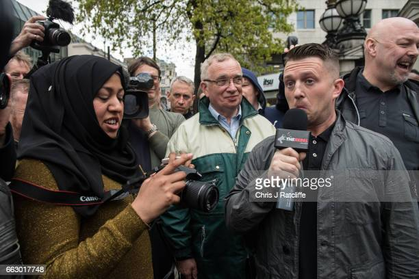 Former English Defence League leader Tommy Robinson reacts as he speaks to a muslim woman during a protest titled 'London march against terrorism' in...