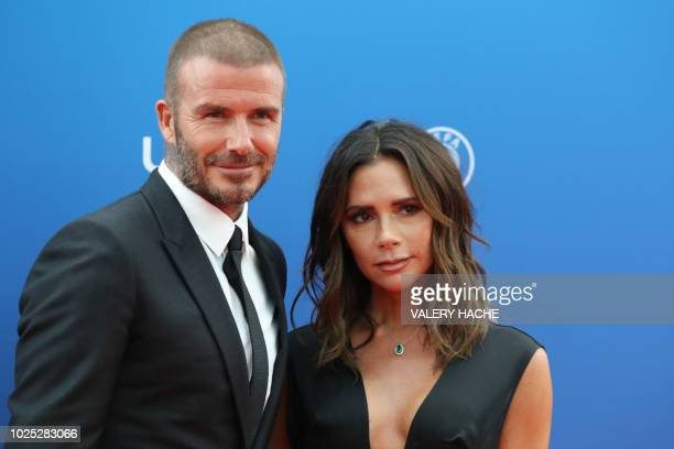 Former English football player David Beckham and his wife Victoria arrive to attend the draw for UEFA Champions League football tournament at The...