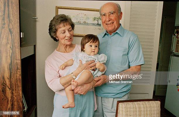 Former English footballer and football manager Sir Alf Ramsey with his wife Lady Victoria and their granddaughter at their daughter's home in...