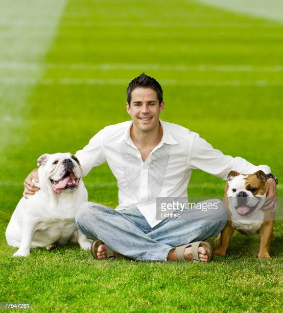 Former English footballer and television pundit Jamie Redknapp with his pet dogs Winston and Bella at home in Surrey on 17th June 2005