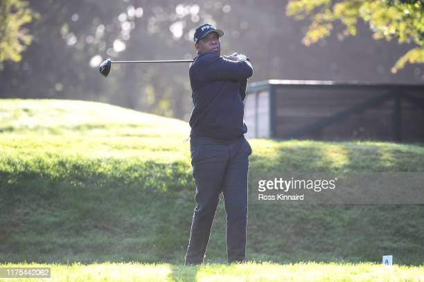 Former English footballer Ian Wright tees off during the ProAm tournament prior to the start of the BMW PGA Championship at Wentworth Golf Club on...