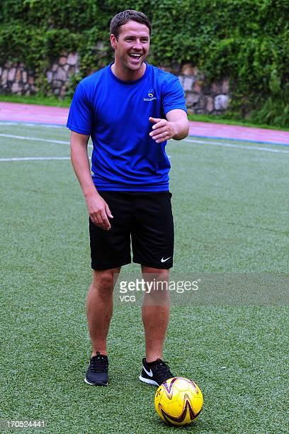 Former English footballer Michael Owen visits Shekou International School on June 13 2013 in Shenzhen China