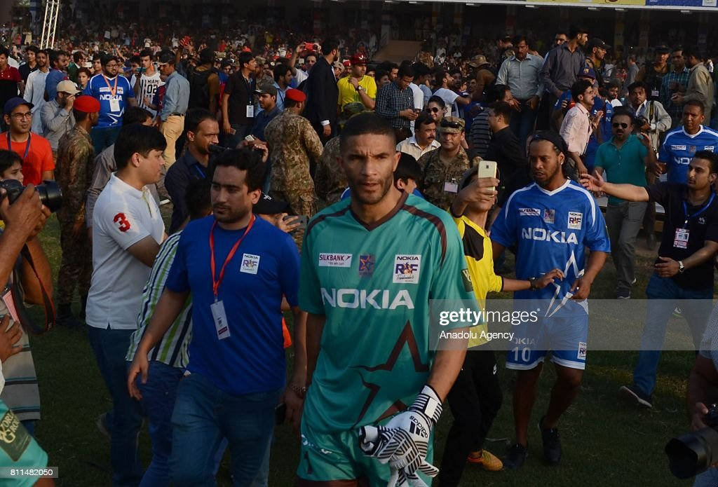 Former English goalkeeper David James and former player of FC Barcelona Ronaldinho arrive for friendly match with Pakistani football players in...