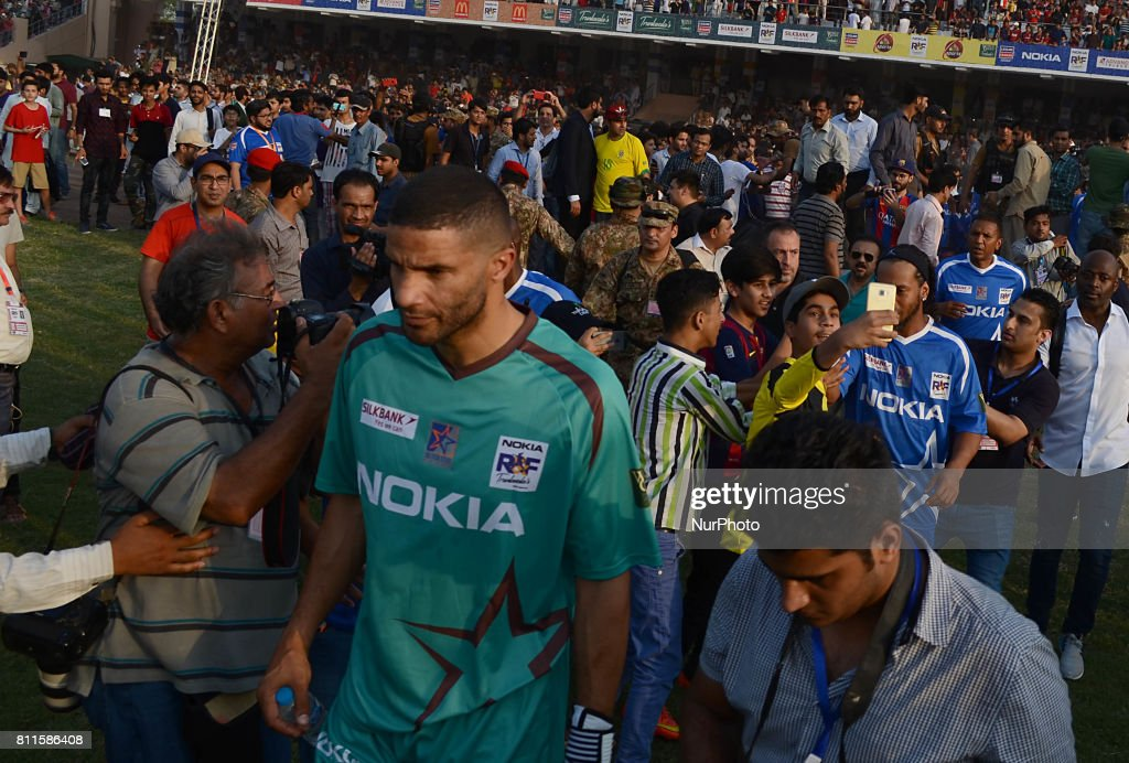 Former English goalkeeper David James Former player of FC Barcelona Brazilian Ronaldinho arrives for friendly match with Pakistani football players...