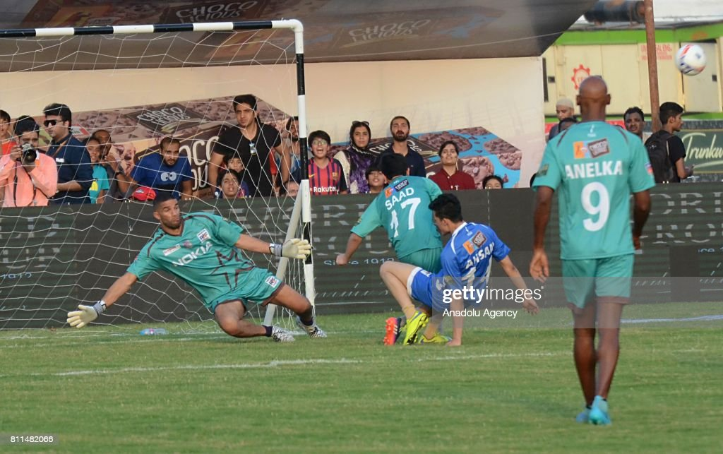 Former English goalkeeper David James tries to catch the ball during friendly match with Pakistani football players in Lahore Pakistan on July 9 2017.