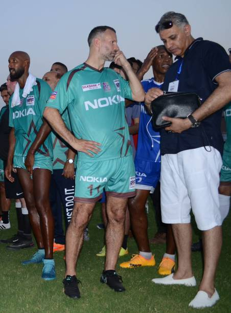 Former English player Ryan Giggs and Former French player Nicolas Anelka are seen during friendly match with Pakistani football players in Lahore...