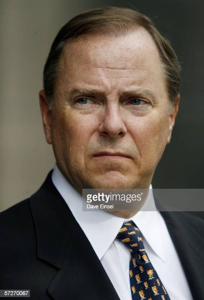 Former Enron CEO Jeff Skilling stands outside the Bob Casey US Courthouse after another day in his fraud and conspiracy trial April 6 2006 in Houston...