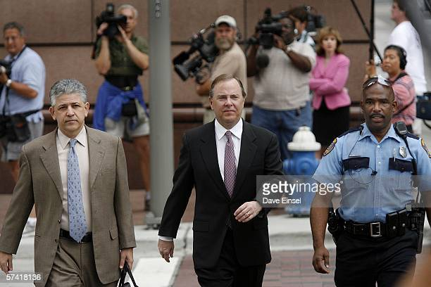 Former Enron CEO Jeff Skilling walks to the Bob Casey US Courthouse with his attorney Daniel Petrocelli and police officer M A Moore for his fraud...