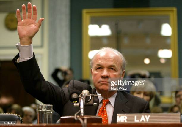Former Enron Chairman Kenneth Lay raises his right hand as he is sworn in before the Senate Committee on Commerce Science and Transportation February...