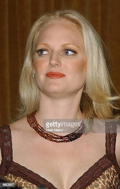 Former Enron employee Christine Nielsen speaks with the media at the Playboy's Women of Enron media conference at Delmonico's June 27 2002 in New...