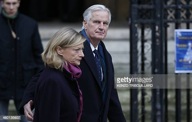 Former EU commissioner Michel Barnier arrives with his wife Isabelle to attend the funeral service of former EU commissioner Jacques Barrot at Saint...