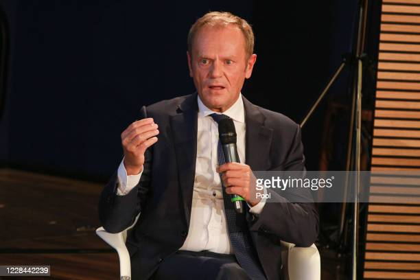 Former EU Council President Donald Tusk takes part in a conversation on the 30th anniversary of the German reunification at Konrad-Adenauer-Stiftung...