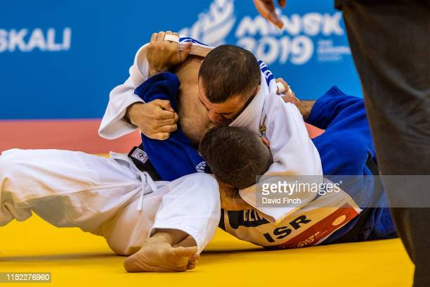 Former European champion, Amiran Papinashvili of Georgia holds Daniel Ben David of Israel for an ippon on his way to the u60kg bronze medal during...